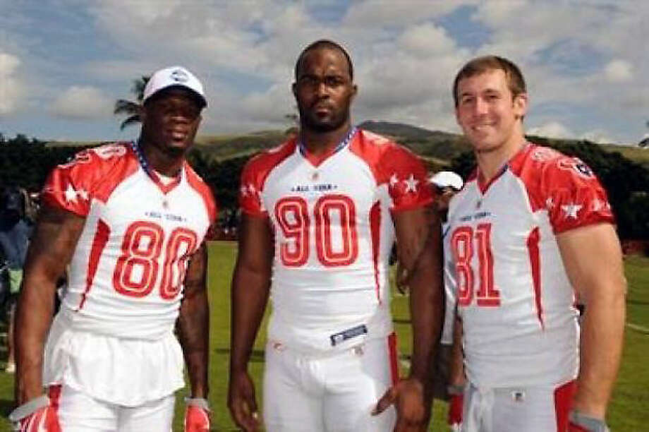 2008 Wide receiver Andre Johnson, left, defensive end Mario Williams and tight end Owen Daniels were named to the 2009 Pro Bowl. It marked Johnson's third trip to the Pro Bowl and the first for Williams and Daniels. Photo: AP