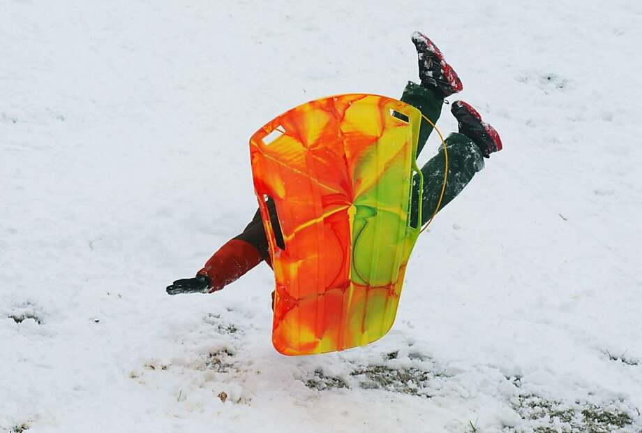 How to t-bone your tailbone: A sledder lands hard and awkwardly in Smithsburg, Md. Photo: Ric Dugan, Associated Press