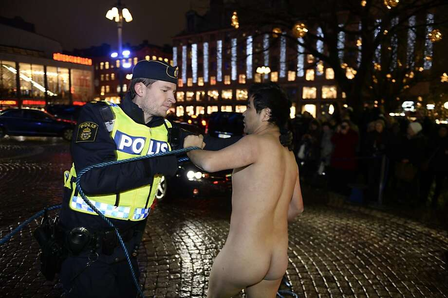 Swedish police detain a naked manduring a protest in Stockholm, where the Nobel prices were awarded in a formal ceremony this week. Chinese artists protested that the 2010 Nobel peace prize winner, Liu Xiaobo, remains in prison in China. Photo: Vilhelm Stokstad, Associated Press