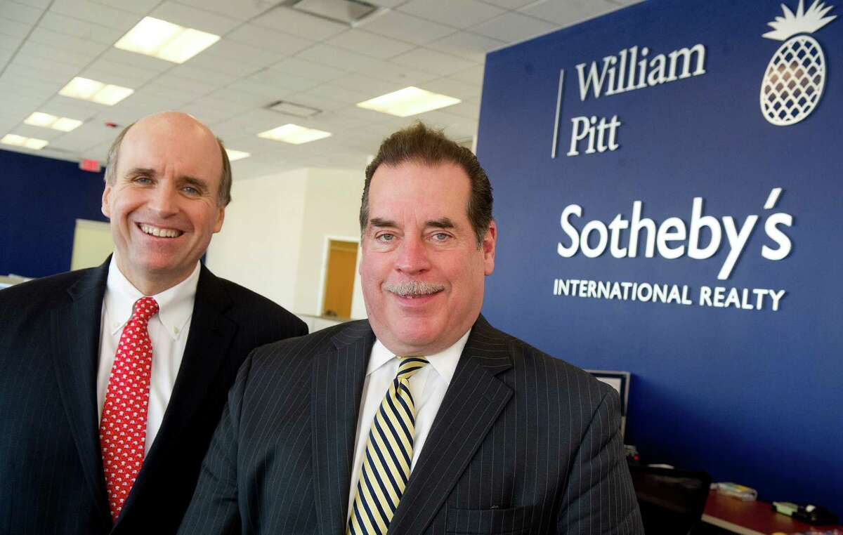 William Pitt Sotheby's CEO Paul Breunich, left, and New Canaan office brokerage manager Bill Larkin, right, pose for a photo in the Stamford office on Wednesday, December 11, 2013.