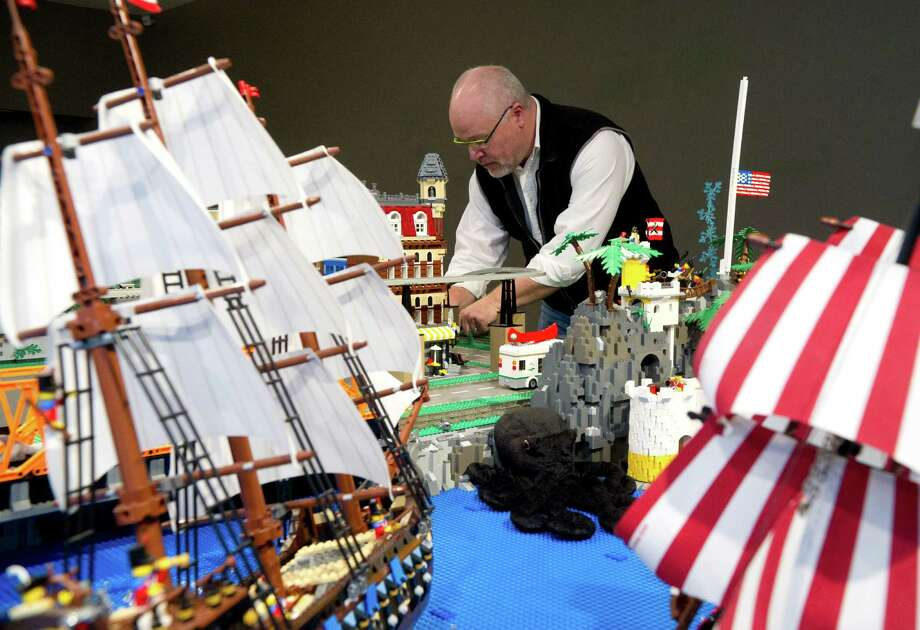 Bill Probert works to set up Lego at the Stamford Museum and Nature Center on Wednesday, December 11, 2013, for A Billion Bricks: Lego T-Rex, Turtles & Trains, which will open Dec. 14, 2013. Photo: Lindsay Perry / Stamford Advocate