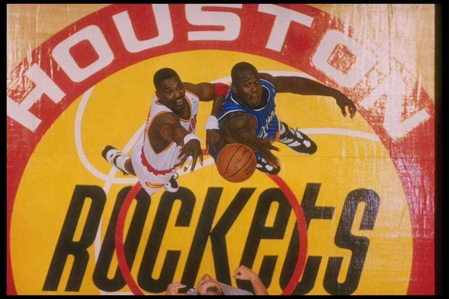 The Rockets were Houston's team of the decade, winning back-to-back NBA Finals in 1994 and 1995. Here, center Hakeem Olajuwon of the Rockets and Orlando Magic center Shaquille O''Neal go up for the ball during a Finals game at The Summit in 1995. Photo: Getty Images / Getty Images North America