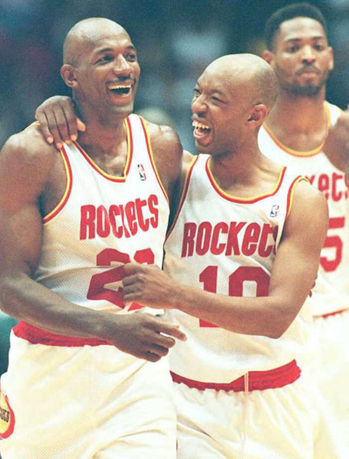 Houston Rockets Clyde Drexler(L) Sam Cassell(C) and Robert Horry celebrate their teams victory over the Orlando Magic June 11, 1995 in game three of the NBA Final at the Summit in Houston. Houston won the game 106-103 to take a 3-0 lead in the best of seven series. Photo: PAUL BUCK, AFP/Getty Images / AFP