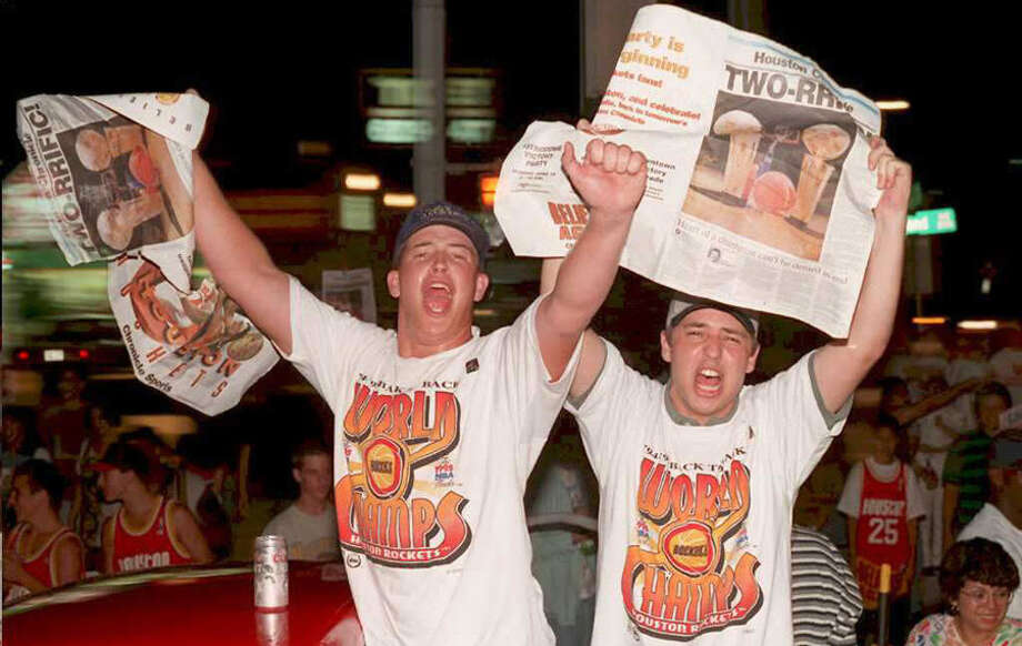 Houston Rockets fans celebrate their teams second straight NBA Championship when they defeated the Orlando Magic 113-101 in game four of the NBA Finals June 14, 1995 at the Summit in Houston. Photo: PAUL BUCK, AFP/Getty Images / AFP