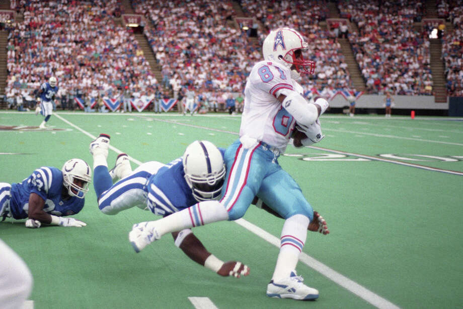 Ernest Givins #81 of the Houston Oilers runs with the ball after a catch against the Indianapolis Colts at the Hoosier Dome on September 4, 1994 in Indianapolis, Ind. The Colts defeated the Oilers 45-21.  Photo: Joe Robbins, Getty Images / 1994 Joe Robbins