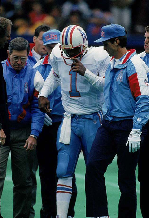 Quarterback Warren Moon #1 of the Oilers is injured during a game and helped off the field. Photo: Jonathan Daniel, Getty Images / Getty Images North America