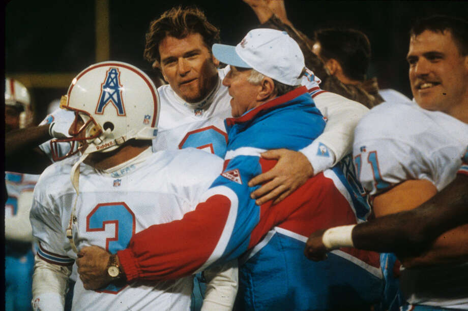 Head coach Jack Pardee of the Houston Oilers hugs kicker Al Del Greco #3 and punter Greg Montgomery #9 after their victory over the San Francisco 49ers at Candlestick Park on December 25, 1993 in San Francisco, Calif. The Oilers defeated the 49ers 10-7.  Photo: Joseph Patronite, NFL / 1993 Joseph Patronite