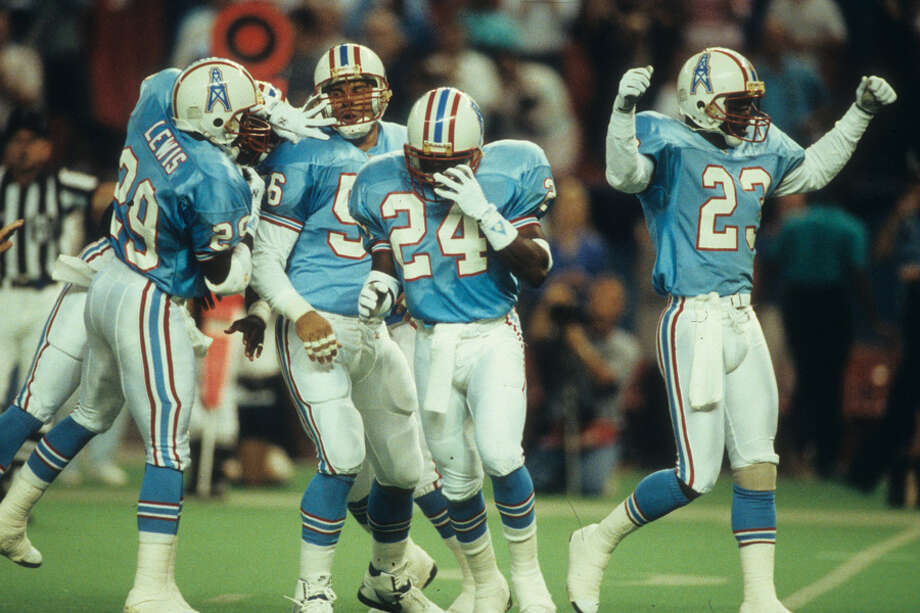 Cornerbacks Steve Jackson #24, Richard Johnson #23 and Darryll Lewis #29 of the Houston Oilers celebrate against the Kansas City Chiefs in the Astrodome, in Houston.  The Oilers defeated the Chiefs 17-7. Photo: Joseph Patronite, NFL / 1991 Joseph Patronite