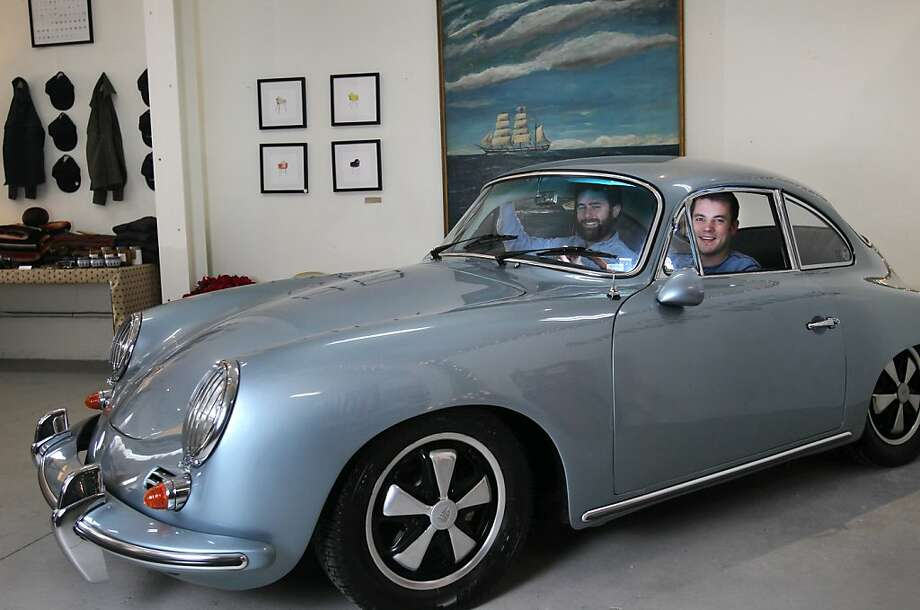 Co-founders of Huckberry, Richard Greiner, left, and Andy Forch pictured in the mint condition 1965 Porsche 356 C, which is for sale December 11, 2013 in the Huckberry Holiday Home pop-up on 3180 17th Street in San Francisco. The home offers everything from furniture from Room & Board to clothing from various brands including Taylor Stitch,Triple Aught Design, American Giant and Juniper Ridge. They also offer a variety of vintage items such as the original Burton snowboard, and an entire camping section from Poler. Small items like shaving kits, watches and flasks are popular. The shop is open until Monday, December 16th. Photo: Leah Millis, The Chronicle