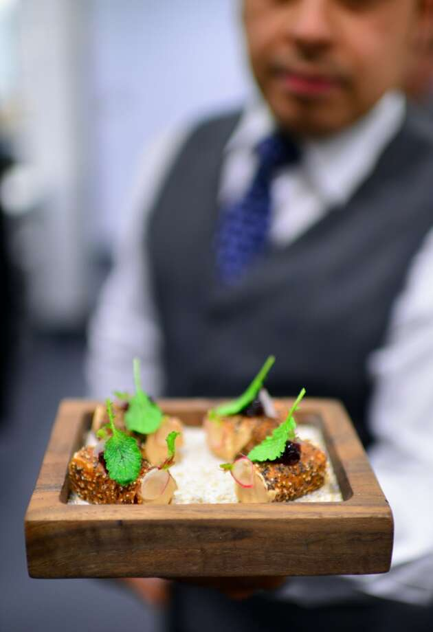 Canape: Liver mousse, amaranth and poppyseed tuile, hibiscus and daikon conserve. Photo: Bonjwing Lee Photography