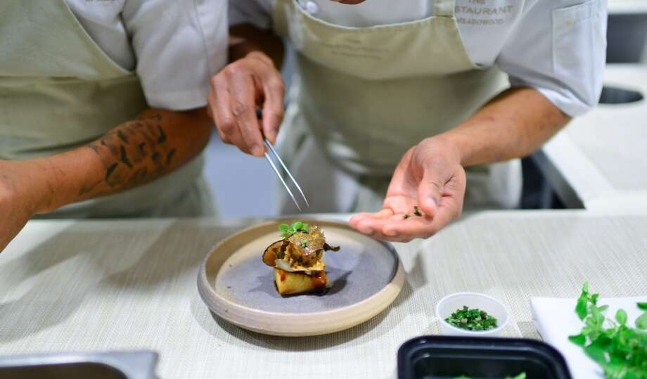 Plating the third course. Photo: Bonjwing Lee Photography