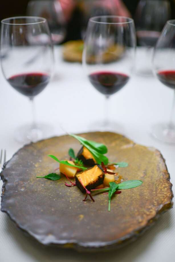 6th Course: Quince-Ashed Mimolette, with quince cooked in habanero. Photo: Bonjwing Lee Photography