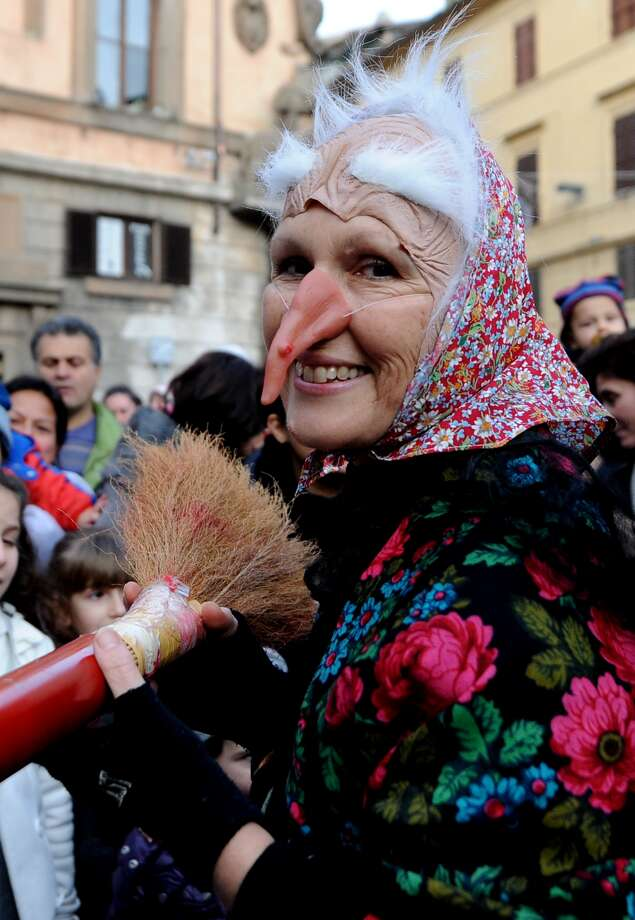 "Italy: La BefanaLa Befana is a lot like Santa Claus, only instead of being a ""jolly old elf"" who rides a sleigh pulled by eight flying reindeer, she's a witch who flies on a broom delivering sweets and treats on the eve of Epiphany Day, which typically falls on January 6. Photo: TIZIANA FABI, AFP/Getty Images"