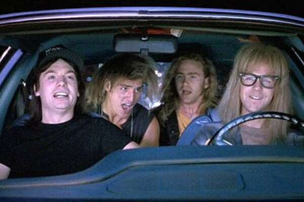 "Wayne's World (1992): When Wayne (Mike Myers) and Garth (Dana Carvey) and friends rock out in the car to Queen's ""Bohemian Rhapsody.""   Watch the clip."