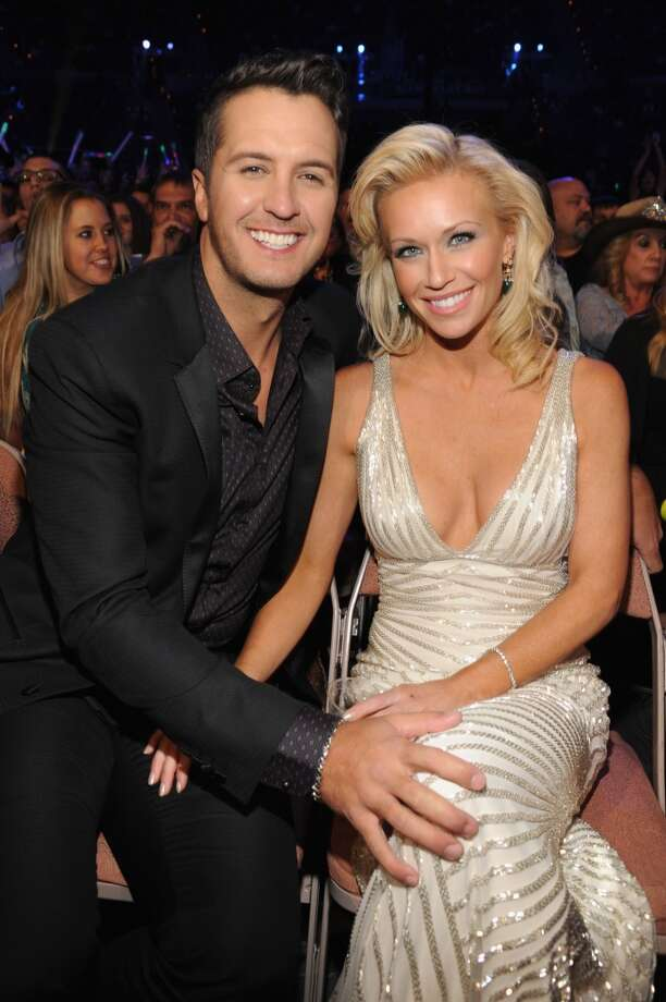Singer Luke Bryan (L) and wife Caroline Bryan attend the American Country Awards 2013 at the Mandalay Bay Events Center on December 10, 2013 in Las Vegas, Nevada.  (Photo by Kevin Mazur/Fox/WireImage) Photo: Kevin Mazur/Fox, WireImage