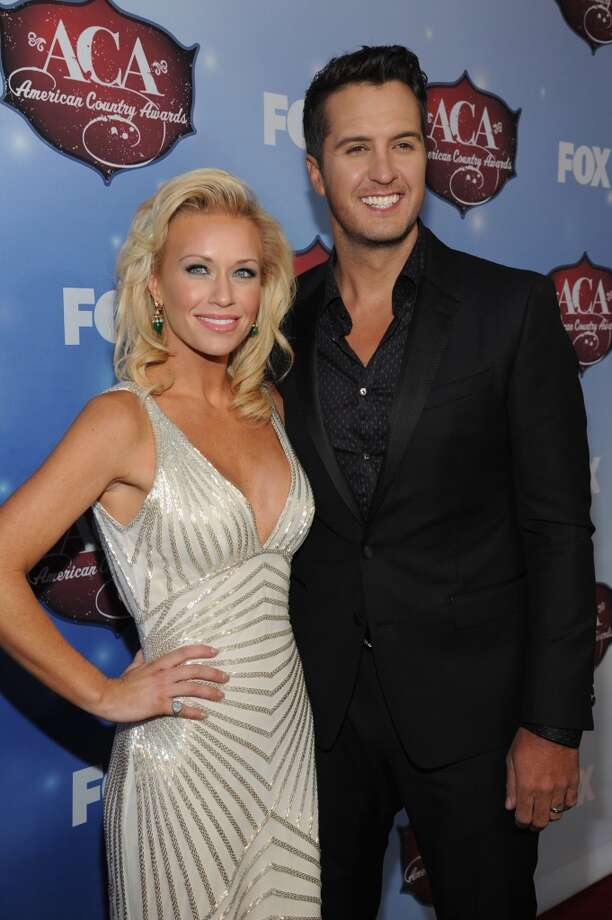 Singer Luke Bryan (R) and wife Caroline Bryan arrive at the American Country Awards 2013 at the Mandalay Bay Events Center on December 10, 2013 in Las Vegas, Nevada.  (Photo by Kevin Mazur/Fox/WireImage) Photo: Kevin Mazur/Fox, WireImage