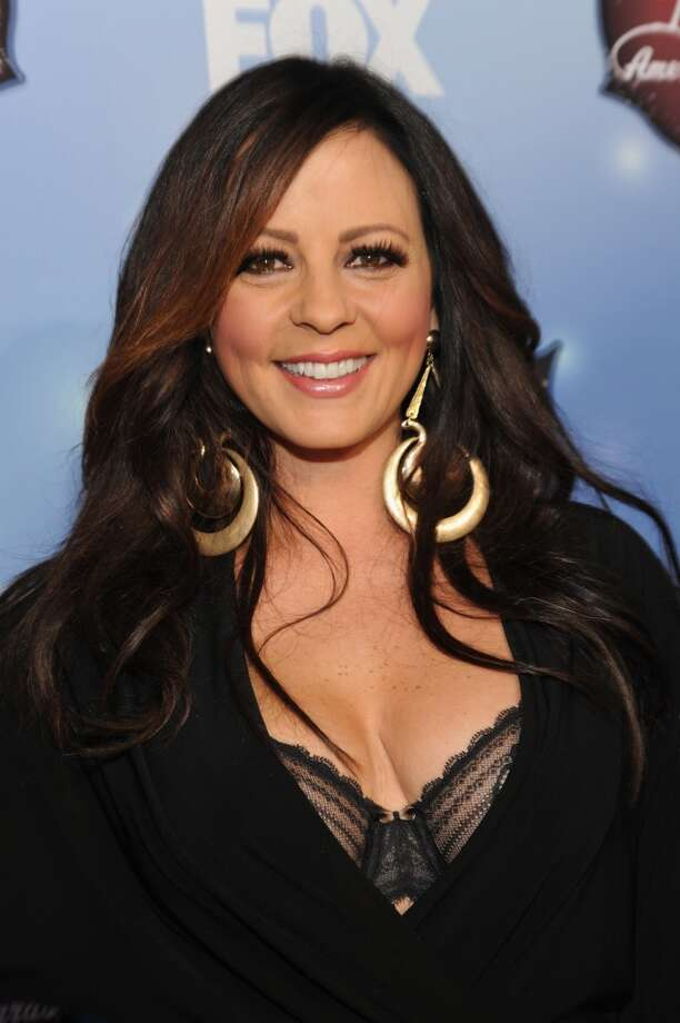 Singer-songwriter Sara Evans arrives at the American Country Awards 2013 at the Mandalay Bay Events Center on December 10, 2013 in Las Vegas, Nevada.  (Photo by Kevin Mazur/Fox/WireImage) Photo: Kevin Mazur/Fox, WireImage