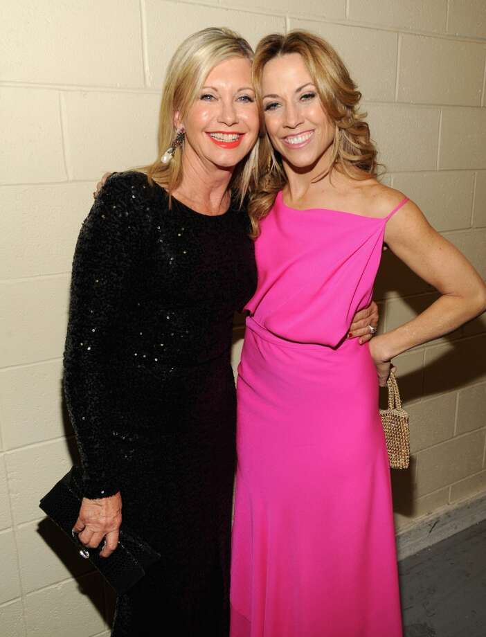 Singers Olivia Newton-John (L) and Sheryl Crow attend the American Country Awards 2013 at the Mandalay Bay Events Center on December 10, 2013 in Las Vegas, Nevada.  (Photo by Kevin Mazur/Fox/WireImage) Photo: Kevin Mazur/Fox, WireImage