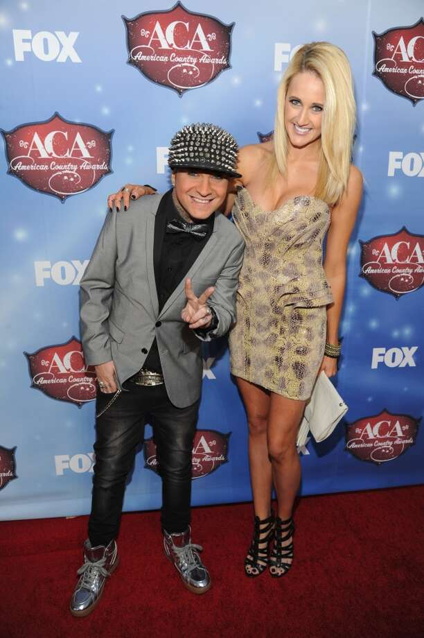 Musician DJ Sinister (L) and model Jenna Straub arrive at the American Country Awards 2013 at the Mandalay Bay Events Center on December 10, 2013 in Las Vegas, Nevada.  (Photo by Kevin Mazur/Fox/WireImage) Photo: Kevin Mazur/Fox, WireImage