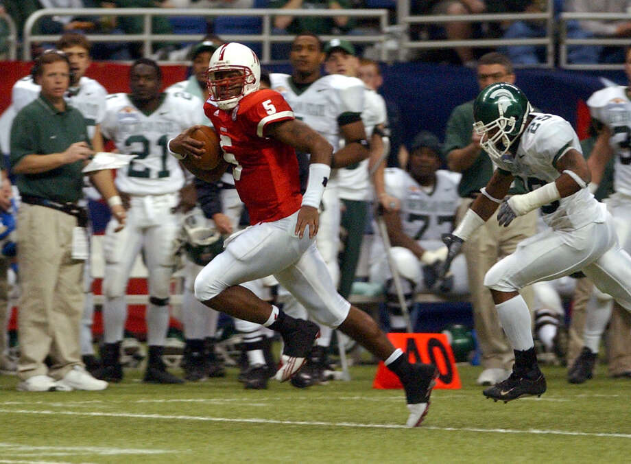 2003: Nebraska quarterback Jammal Lord, 5, outruns Michigan State defender Jason Harmon, 25, to set up a touchdown in the first half of the MasterCard Alamo Bowl at the Alamodome in San Antonio on Monday, December 29, 2003. Nebraska won 17-3. Photo: KIN MAN HUI, SAN ANTONIO EXPRESS-NEWS / SAN ANTONIO EXPRESS-NEWS
