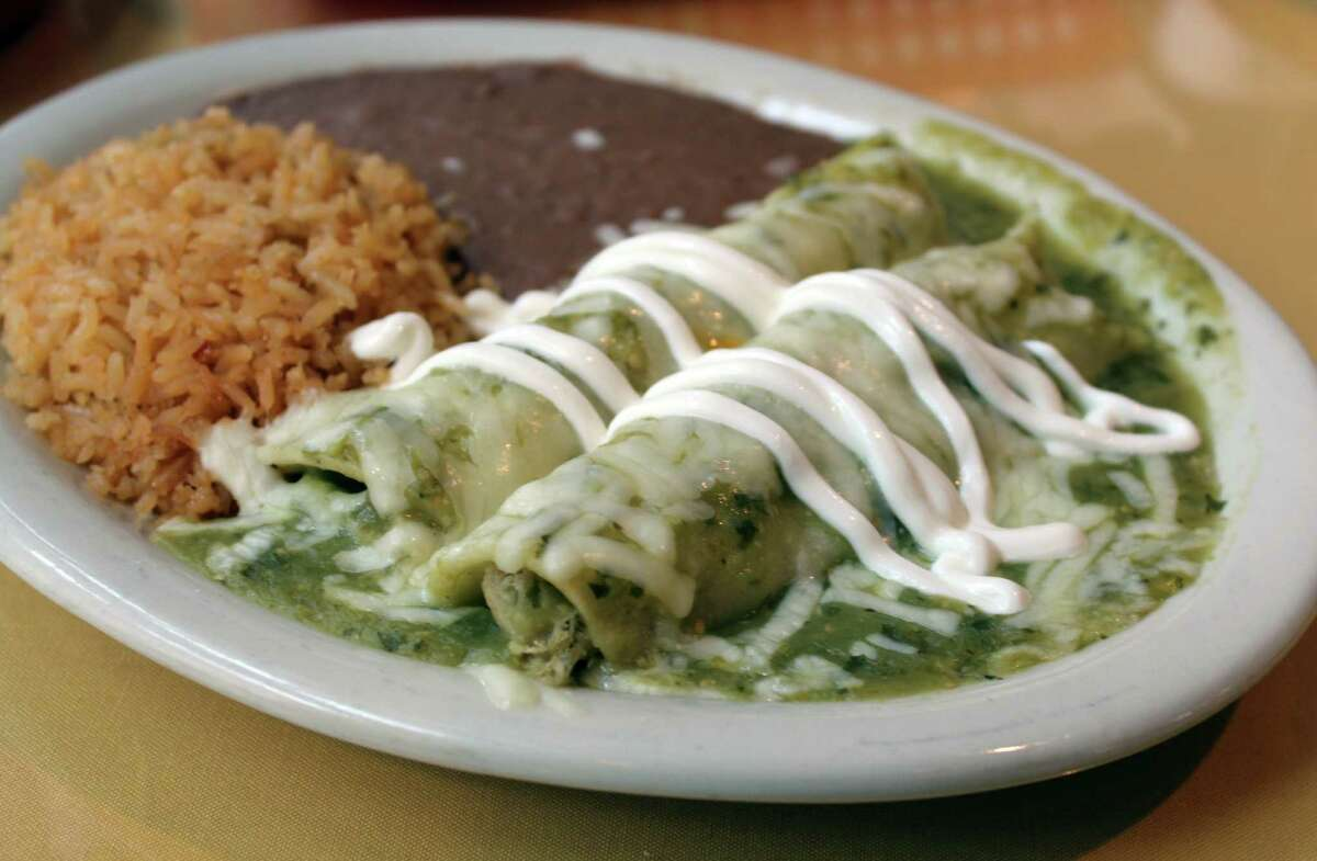 A plate of green enchiladas at Poblano's on Main comes with rice and beans and just the right amount of sauce.