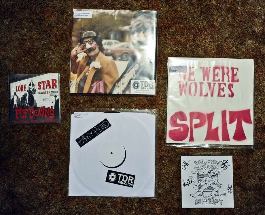 Welcoming us into his home on Tuesday, January 15, 2013, Jordan Payne shows us his collection of almost 700 pieces of vinyl including these pieces of vinyl put out by local bands such as Barely Blind, We Were Wolves, and The Put-Downs. Photo taken: Randy Edwards/The Enterprise Photo: Randy Edwards