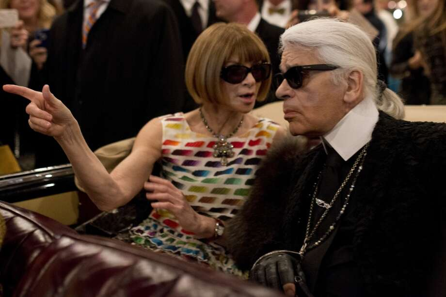 "DALLAS, TX - DECEMBER 10:  Anna Wintour and Karl Lagerfeld speak to eachother during the Chanel ""Metiers d'Art"" Show at Fair Park on December 10, 2013 in Dallas, Texas.  (Photo by Cooper Neill/Getty Images for Chanel) Photo: Cooper Neill"
