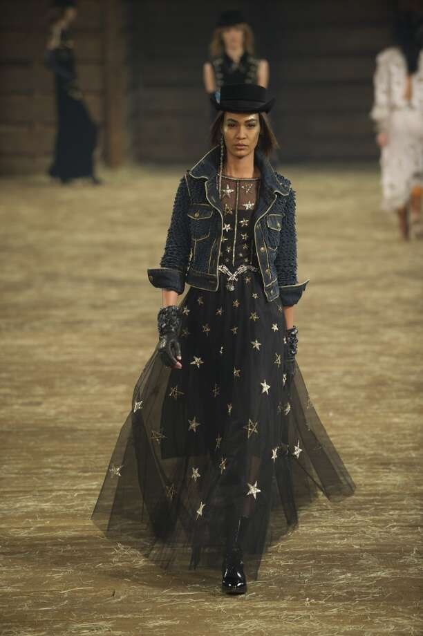 "DALLAS, TX - DECEMBER 10:  Model Joan Smalls walks the runway during the Chanel ""Metiers d'Art"" Show at Fair Park on December 10, 2013 in Dallas, Texas.  (Photo by Cooper Neill/Getty Images for Chanel) Photo: Cooper Neill"