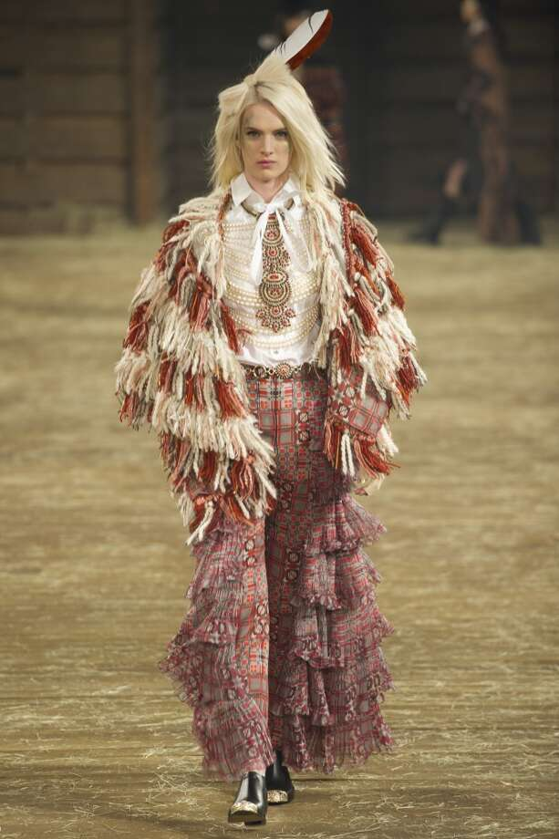 "DALLAS, TX - DECEMBER 10:  A model walks the runway during the Chanel ""Metiers d'Art"" Show at Fair Park on December 10, 2013 in Dallas, Texas.  (Photo by Cooper Neill/Getty Images for Chanel) Photo: Cooper Neill"