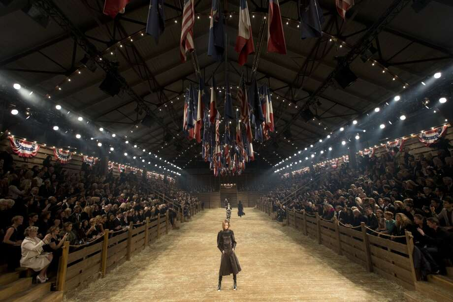 "DALLAS, TX - DECEMBER 10:  Models walk the runway during the Chanel ""Metiers d'Art"" Show at Fair Park on December 10, 2013 in Dallas, Texas.  (Photo by Cooper Neill/Getty Images for Chanel) Photo: Cooper Neill"