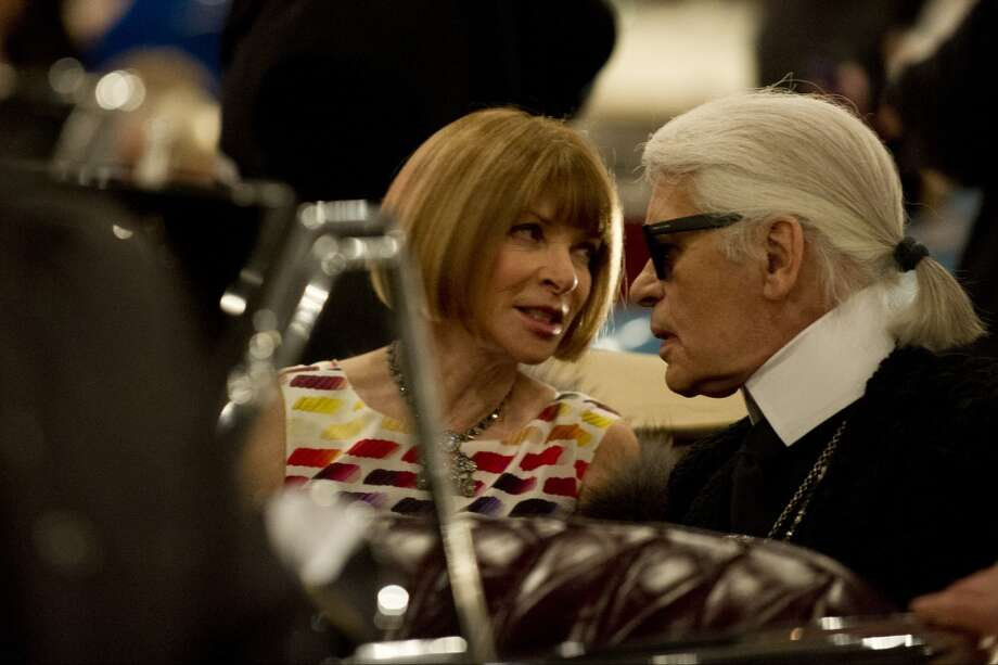 "DALLAS, TX - DECEMBER 10:  Anna Wintour and Karl Lagerfeld speak during the Chanel ""Metiers d'Art"" Show at Fair Park on December 10, 2013 in Dallas, Texas.  (Photo by Cooper Neill/Getty Images for Chanel) Photo: Cooper Neill"
