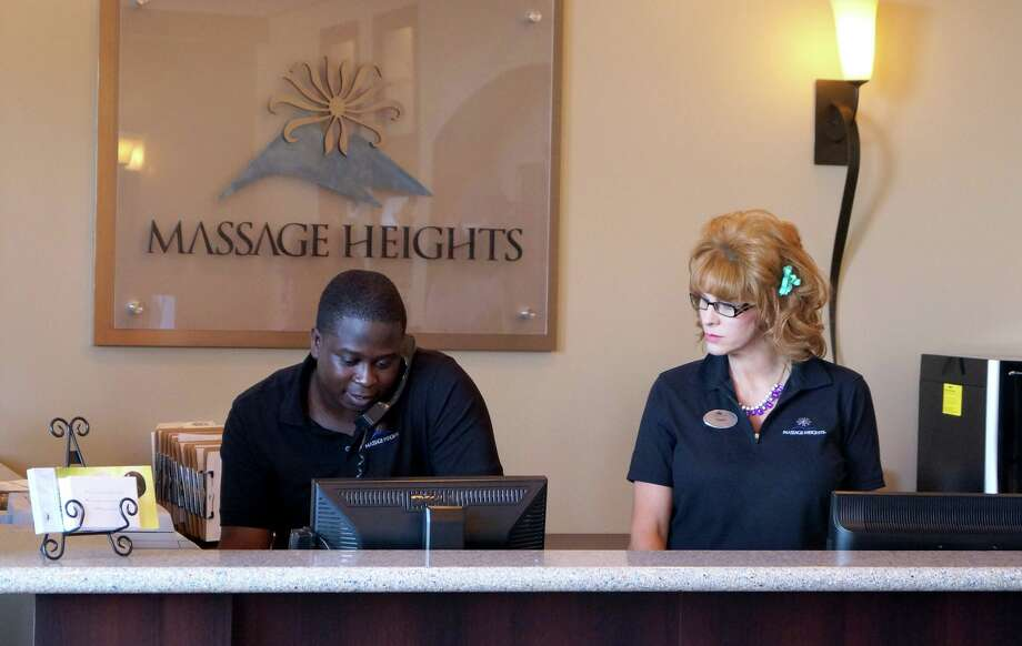 "In ""Undercover Boss,"" a disquised Shane Evans, right, chief operating officer of Massage Heights, gets to know some of her employees, including Kenny Thomas from a Houston location. Photo: -- / 2013 CBS Networks"