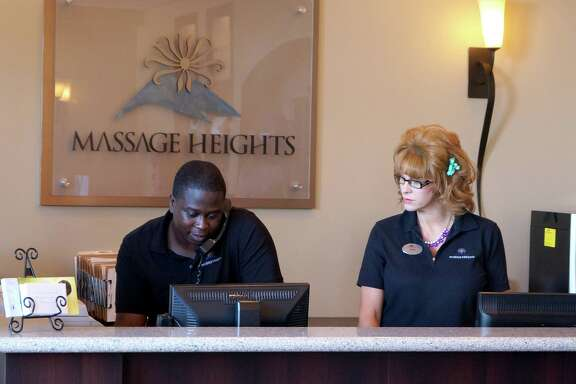 "In ""Undercover Boss,"" a disquised Shane Evans, right, chief operating officer of Massage Heights, gets to know some of her employees, including Kenny Thomas from a Houston location."