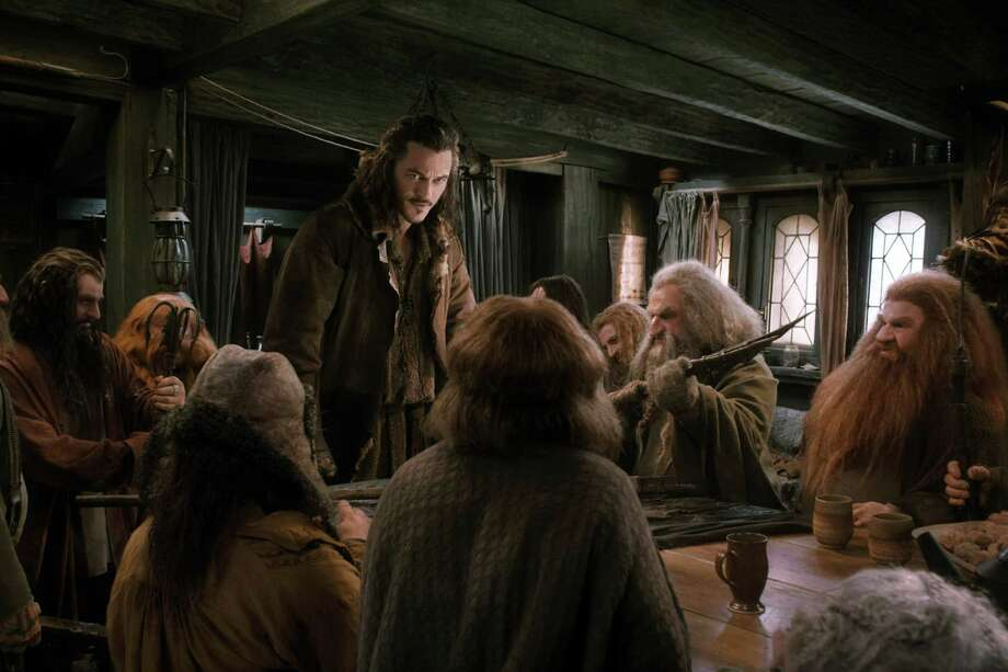 "Luke Evans, standing, stars in ""The Hobbit: The Desolation of Smaug."" Photo: HOEP / Warner Bros. Pictures"