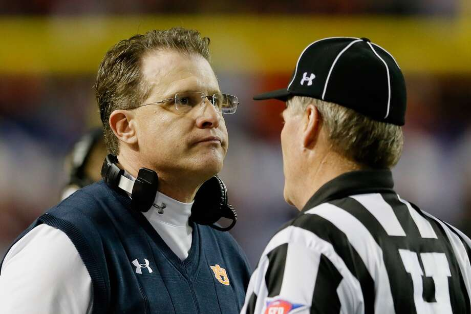 Only a few years ago, Malzahn was one of the most impressive high school coaches in the nation, ringing up monster numbers with his offenses at Springdale, Ark. From there, he was a highly regarded assistant at Arkansas and Tulsa before leading Arkansas State to a 9-3 record and a conference championship last year. This season, he's led Auburn's storybook rise, going from 3-9 in 2012 to the SEC title and the BCS championship game. And yes, Texas fans, he can do wonders with junior-college quarterbacks like Nick Marshall. Photo: Kevin C. Cox, Getty Images