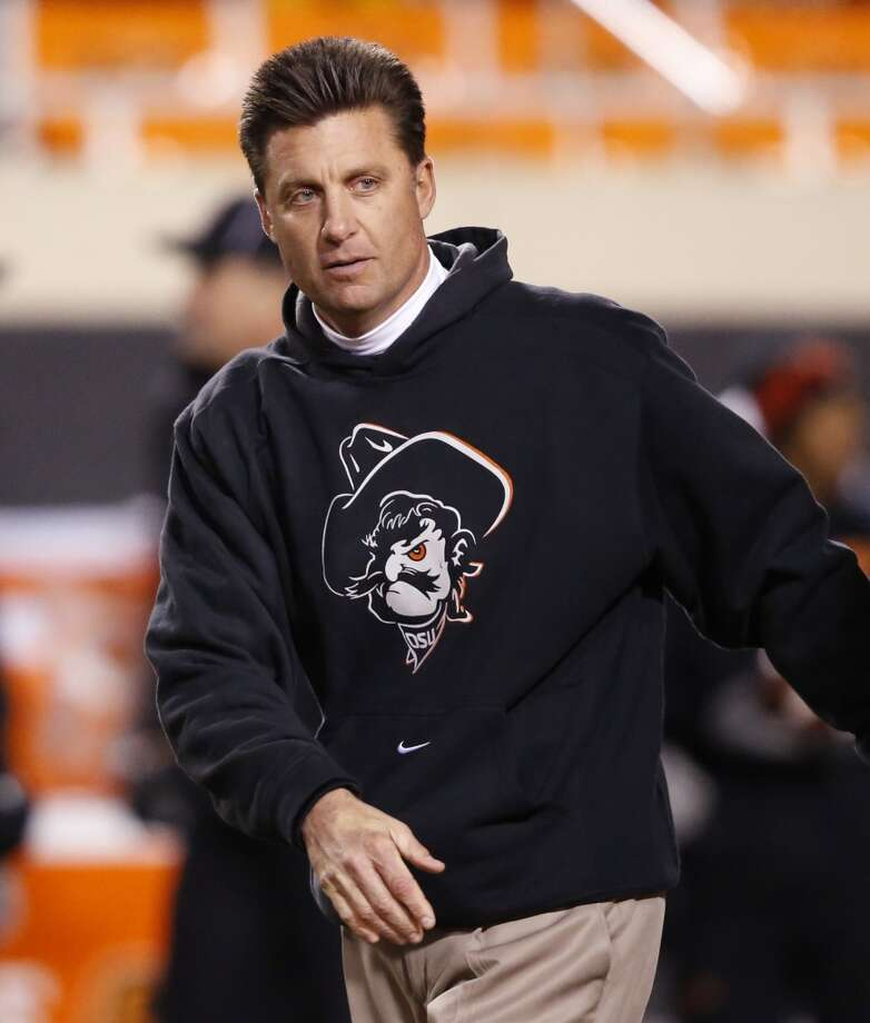 If the Longhorns stay in the Big 12, they would find an appealing candidate in Gundy, who has turned the Cowboys into a consistent national power, coming within a whisper of the BCS title game in 2011. Gundy has deep ties to the school after his football career there, but might be willing to consider jumping if he's feuding with OSU mega-booster Boone Pickens and athletic director Mike Holder on that day. He's developed an accomplished program heavy with Texas high school players. He's also shown a knack for running his program consistently even after a number of high-profile assistants have come and gone. Yes, he can be prickly in post-game interview sessions. And the allegations about his program in a Sports Illustrated series didn't paint show him in an attractive light. But giving him the chance to utilize Texas' natural advantages might push the Longhorns back into the national elite very quickly. Photo: Sue Ogrocki, Associated Press