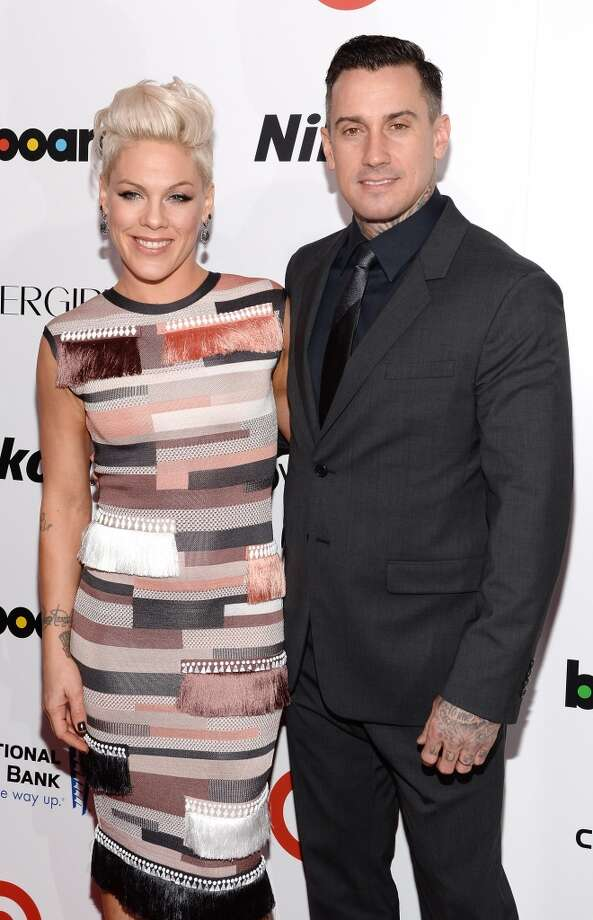 Singer-songwriter P!nk and motorcycle racer Carey Hart attend Billboard's annual Women in Music event at Capitale on December 10, 2013 in New York City.  (Photo by Larry Busacca/Getty Images) Photo: Larry Busacca, Getty Images