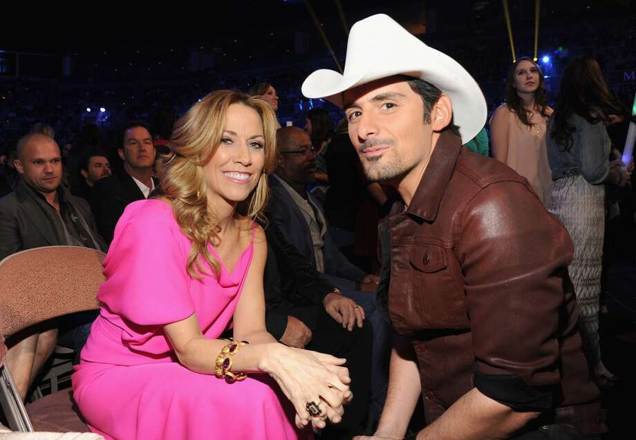 Singers Sheryl Crow (L) and Brad Paisley attend the American Country Awards 2013 at the Mandalay Bay Events Center on December 10, 2013 in Las Vegas, Nevada.  (Photo by Kevin Mazur/Fox/WireImage) Photo: Kevin Mazur/Fox, WireImage