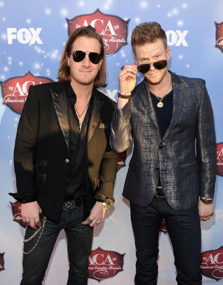 Musicians Tyler Hubbard (L) and Brian Kelley of Florida Georgia Line arrive at the American Country Awards 2013 at the Mandalay Bay Events Center on December 10, 2013 in Las Vegas, Nevada.  (Photo by Kevin Mazur/Fox/WireImage) Photo: Kevin Mazur/Fox, WireImage
