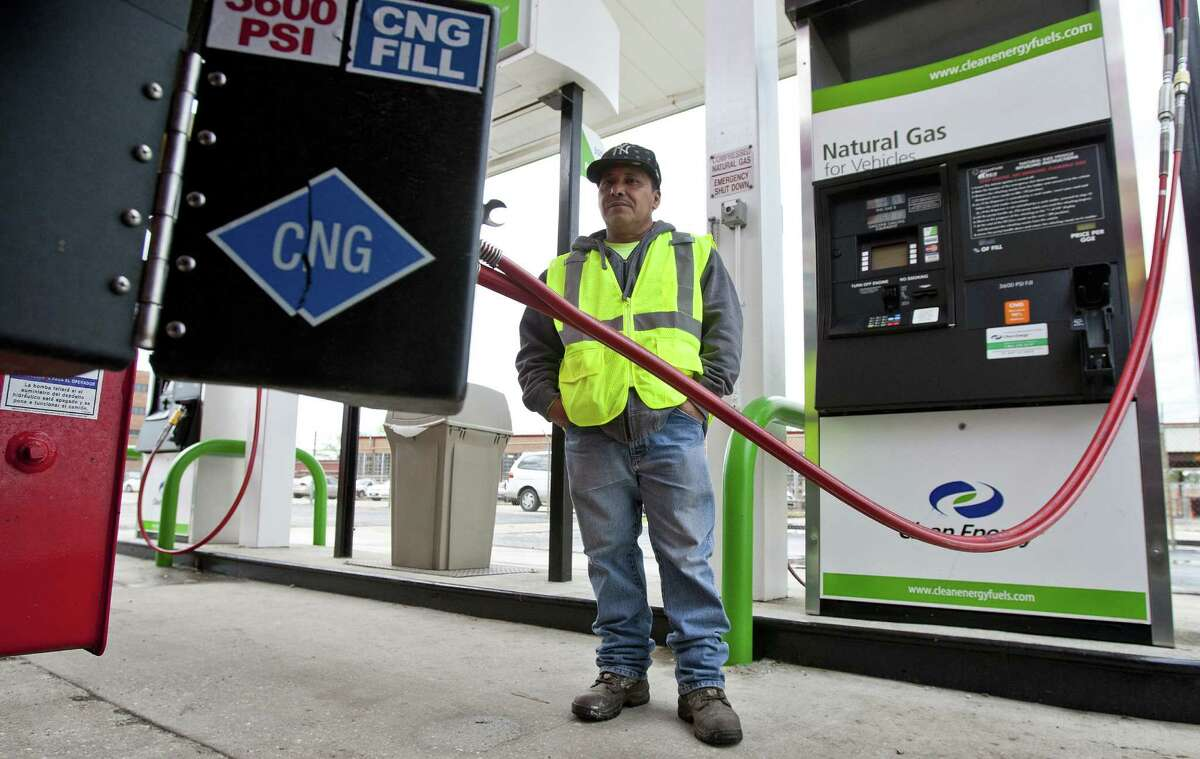 Manuel Palma of Royal Recycle and Disposal fills up in Houston. A network of natural gas fueling stations along highways that link San Antonio, Austin, Dallas, Fort Worth and Houston is growing.