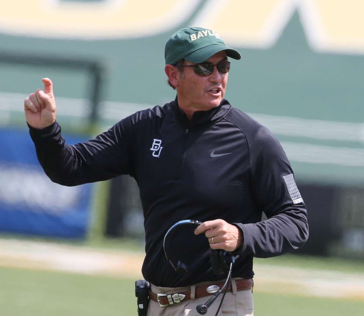 Coach of the year -- Baylor coach Art Briles. When he arrived at Baylor, the Bears had won 11 Big 12 games in their previous 12-season history in the conference. His transformation is complete after leading the Bears to an 11-1 record, their first Big 12 football title and their first BCS bowl appearance Jan. 1 against UCF in the Fiesta Bowl. It's the kind of building project that should result in Briles one day having a statue in his honor at the new Baylor Stadium that will be opening next season.