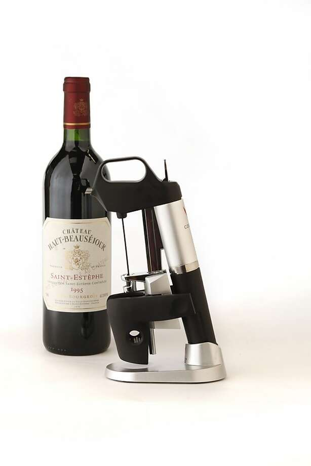 The $299 Coravin does not pull the cork, allowing users to enjoy a single glass. Photo: Craig Lee, Special To The Chronicle