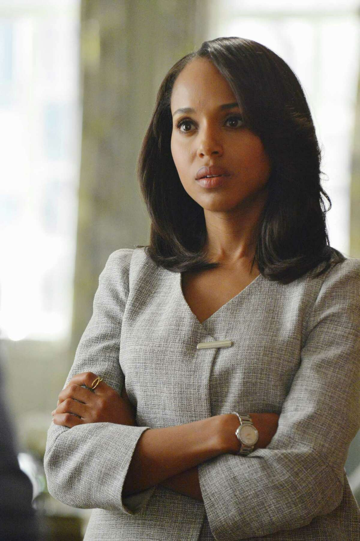 Kerry Washington plays political super-fixer Olivia Pope. Washington, who's married to football player Nnamdi Asomugha (NAHM'-dee AH'-suhm-wah), is pregnant, which may be part of the reason why ABC is shortening the current season by three episodes.