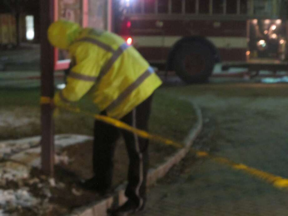 A University of Bridgeport security staff member blocking off the area around the John J. Cox Student Center, which caught fire Wednesday night. The building did not apparently suffer any major damage. Photo: Wes Duplantier, Connecticut Post