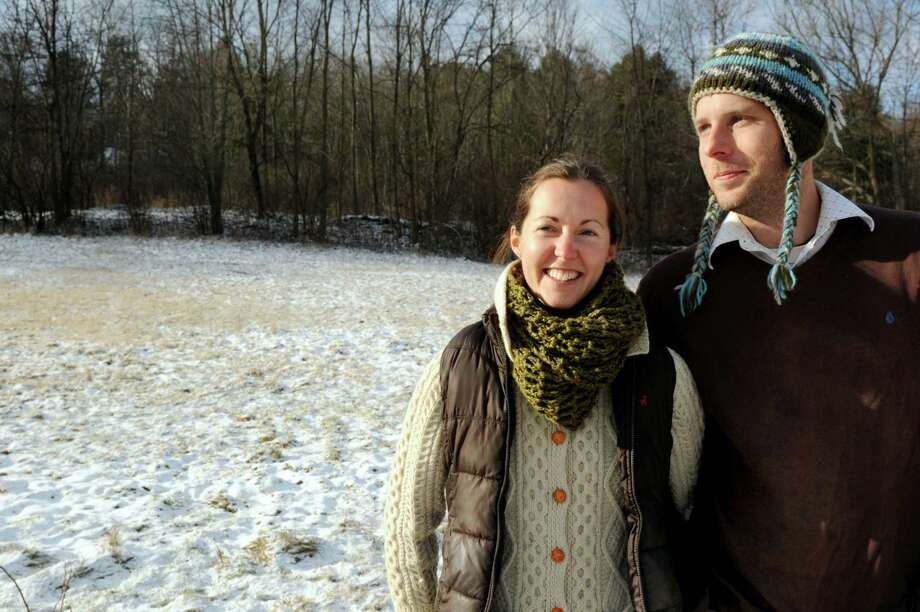 Jen O'Connor, left, and her husband, Eric Krans, with a small, sledding hill behind them on Wednesday, Dec. 11, 2013, at their home in Altamont, N.Y. O'Connor penned a letter to the Altamont Enterprise inviting local children to sled on the hill, a tradition her grandfather started years ago. (Cindy Schultz / Times Union) Photo: Cindy Schultz / 00024985A