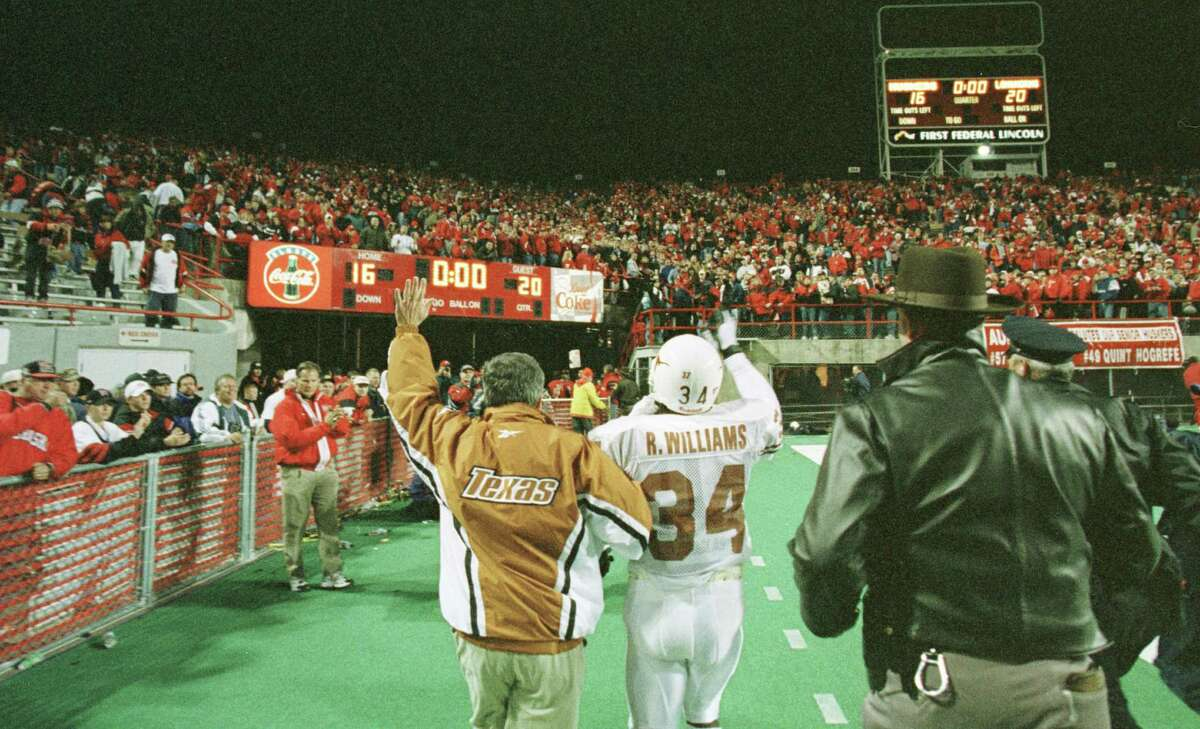 In a touch of class, Nebraska fans toast Texas coach Mack Brown and running back Ricky Williams, who salute them back, with a standing ovation as they leave the field after ending Nebraska's 47-game home winning streak on Saturday. Nebraska fans had made a tradition out of cheering the opposition after each win during the streak.
