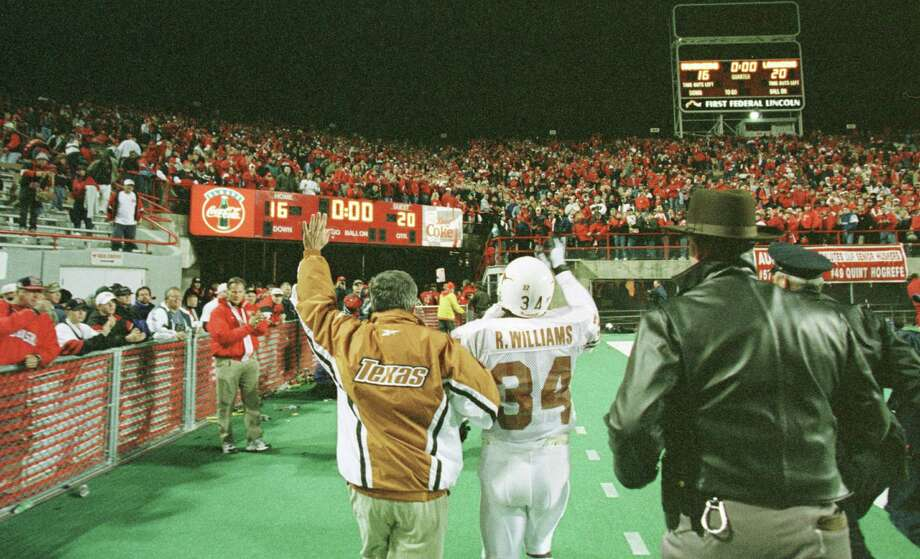 In a touch of class, Nebraska fans toast Texas coach Mack Brown and running back Ricky Williams, who salute them back, with a standing ovation as they leave the field after ending Nebraska's 47-game home winning streak on Saturday.  Nebraska fans had made a tradition out of cheering the opposition after each win during the streak. Photo: D. Fahleson, Houston Chronicle / Houston Chronicle