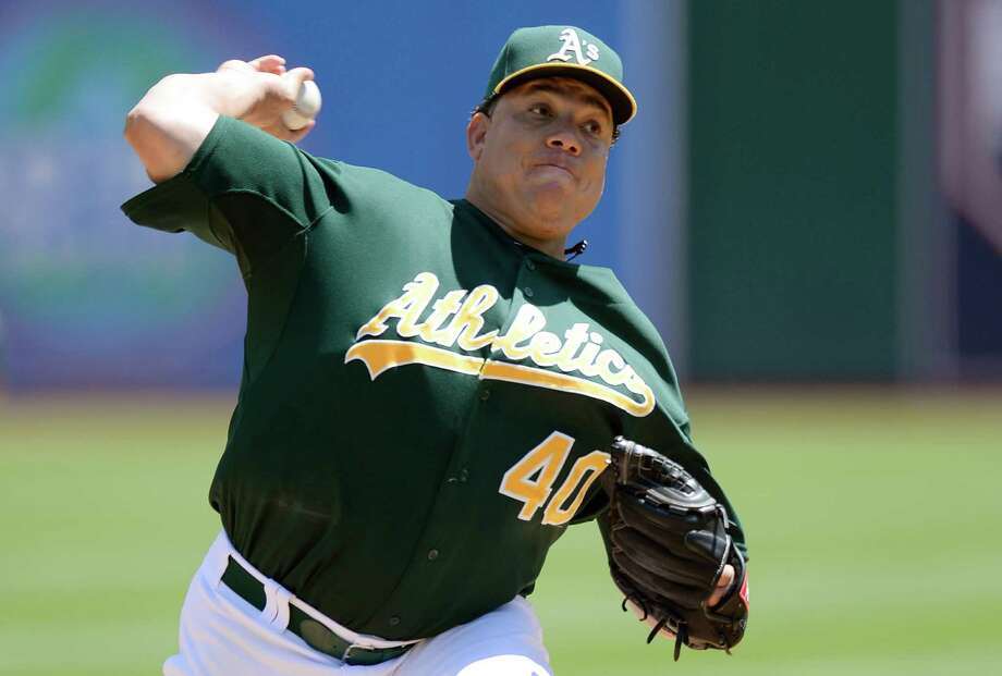 OAKLAND, CA - JULY 31:  Bartolo Colon #40 of the Oakland Athletics pitches against the Toronto Blue Jays at O.co Coliseum on July 31, 2013 in Oakland, California.  (Photo by Thearon W. Henderson/Getty Images) ORG XMIT: 163494801 Photo: Thearon W. Henderson / 2013 Getty Images