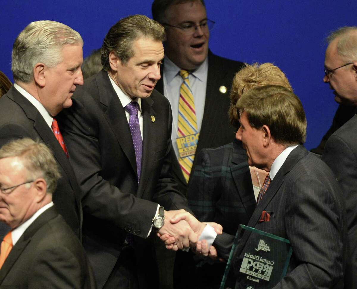 Jim Barba, president and CEO of Albany Med, is congratulated by Albany Governor Andrew Cuomo, second from left, and Mayor Jerrings, left, after the Capital Regional Council received $82.8 million during the Regional Economic Development Awards Wednesday morning, Dec. 11, 2013, in Albany, N.Y. (Skip Dickstein / Times Union)