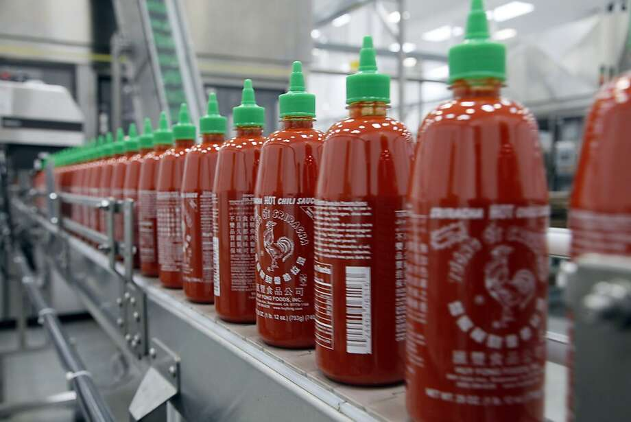 The Sriracha factory makes 3,000 bottles an hour 24 hours a day, 6 days a week.  That's 70,000 a week and they've just moved to a factory 2.5 times bigger. Photo: Nick Ut, Associated Press